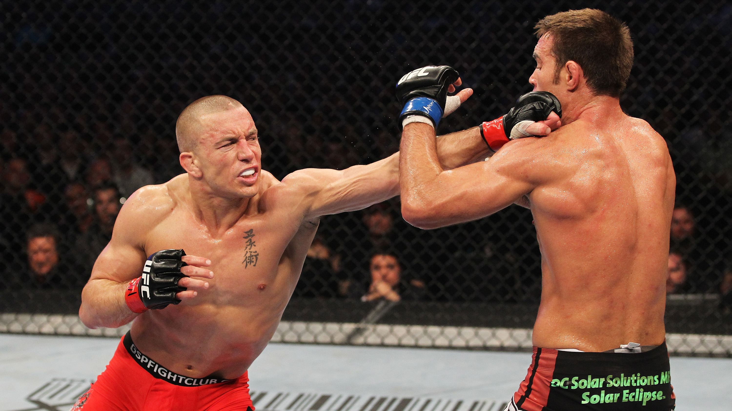 TORONTO, ON - APRIL 30:  Georges St-Pierre (L) punches <a href='../fighter/Jake-Shields'>Jake Shields</a> during their Welterweight Championship bout at <a href='../event/UFC129'>UFC 129 </a>in the Rogers Centre on April 30, 2011 in Toronto, Ontario. (Photo by Al Bello/Zuffa LLC)