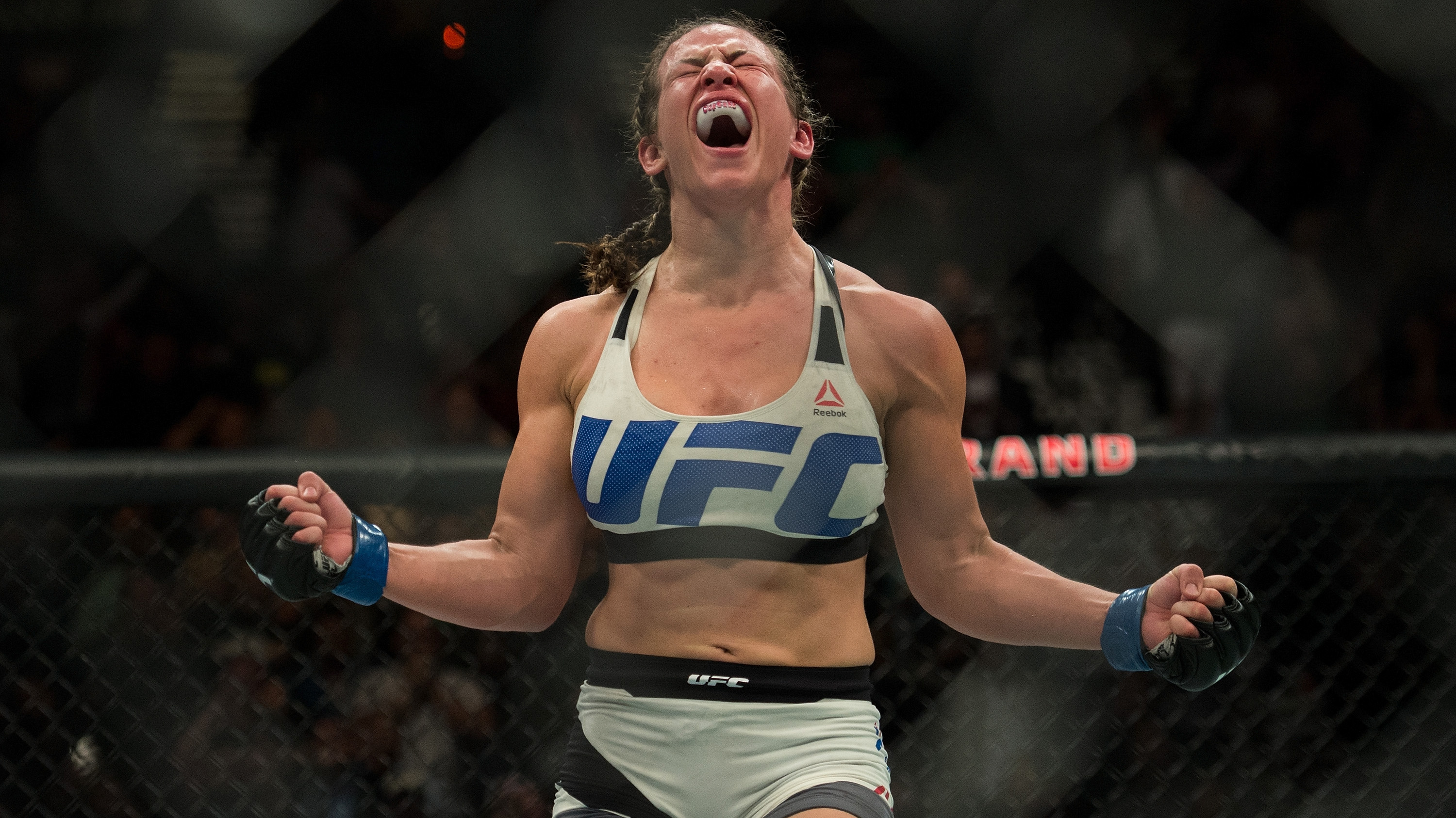 Miesha Tate celebrates after defeating Holly Holm at UFC 196