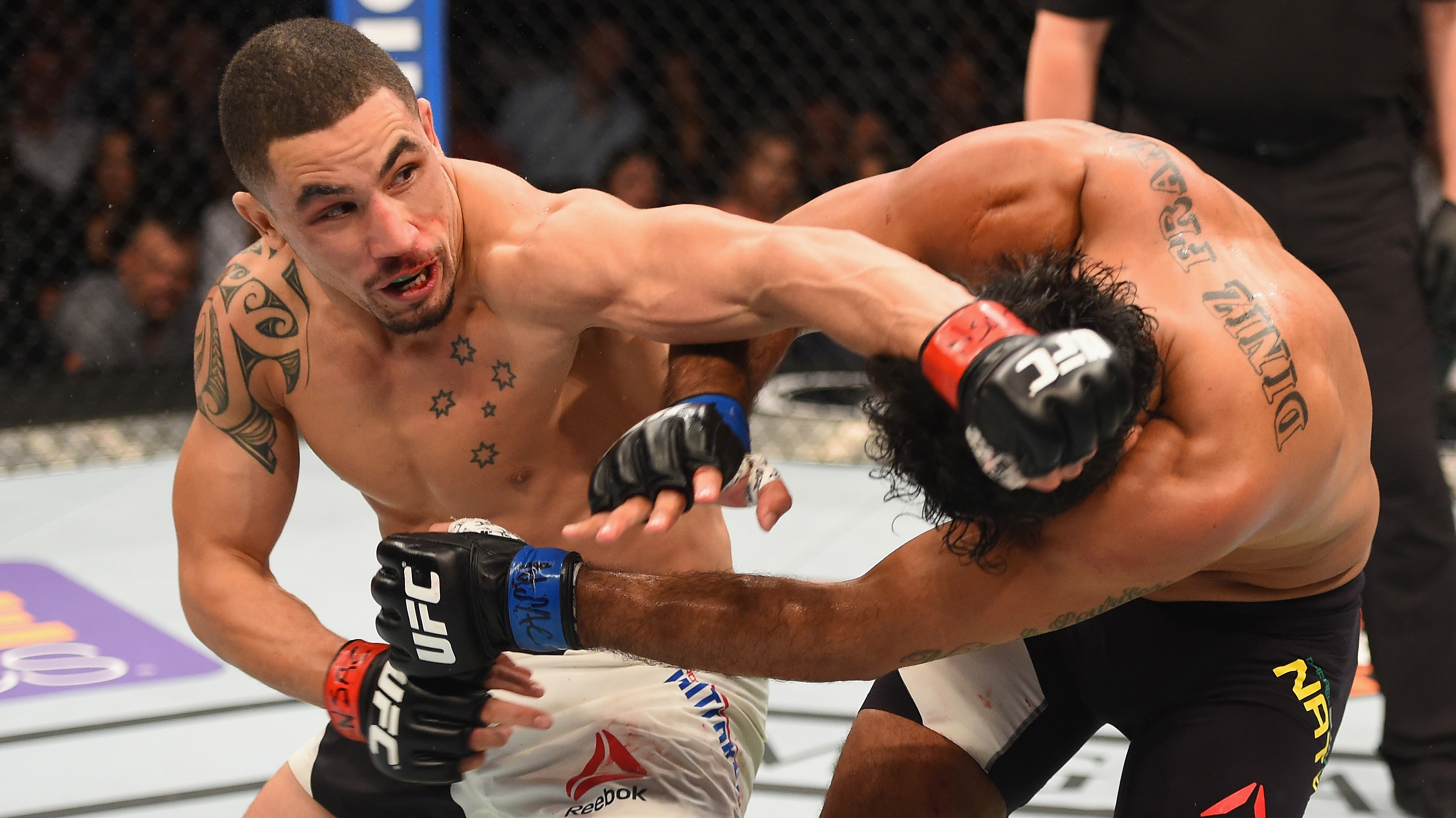 Robert Whittaker punches &lt;a href='../fighter/rafael-natal'&gt;<a href='../fighter/rafael-natal'>Rafael Natal</a>&lt;/a&gt; during his most recent win at UFC 197
