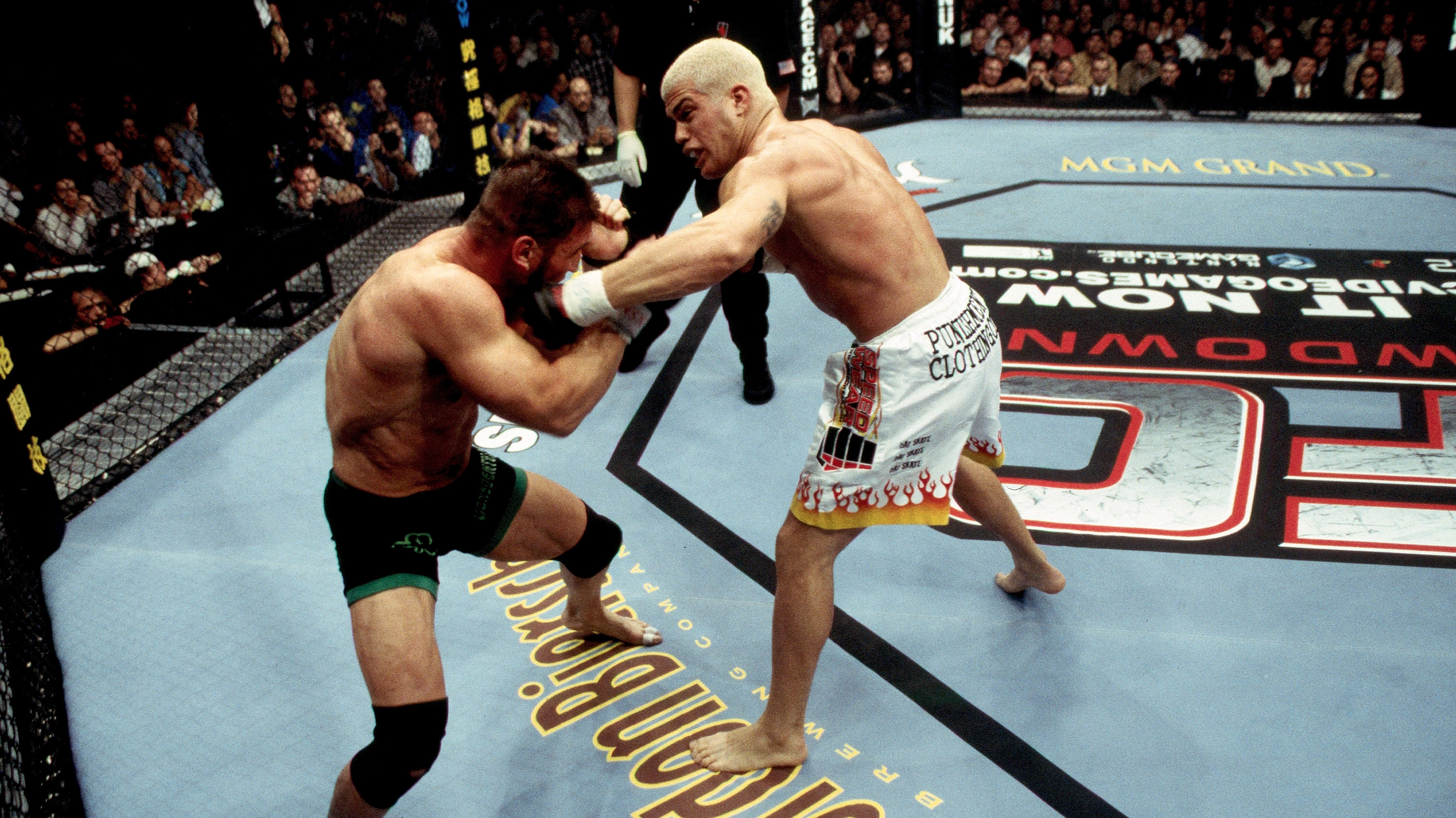 LAS VEGAS - NOVEMBER 22:  Tito Ortiz (white shorts) and <a href='../fighter/Ken-Shamrock'>Ken Shamrock</a> (black shorts) battle during <a href='../event/UFC-40-Vendetta'>UFC 40 </a>at the MGM Grand Garden Arena on November 22, 2002 in Las Vegas, Nevada. (Photo by Josh Hedges/Zuffa LLC)