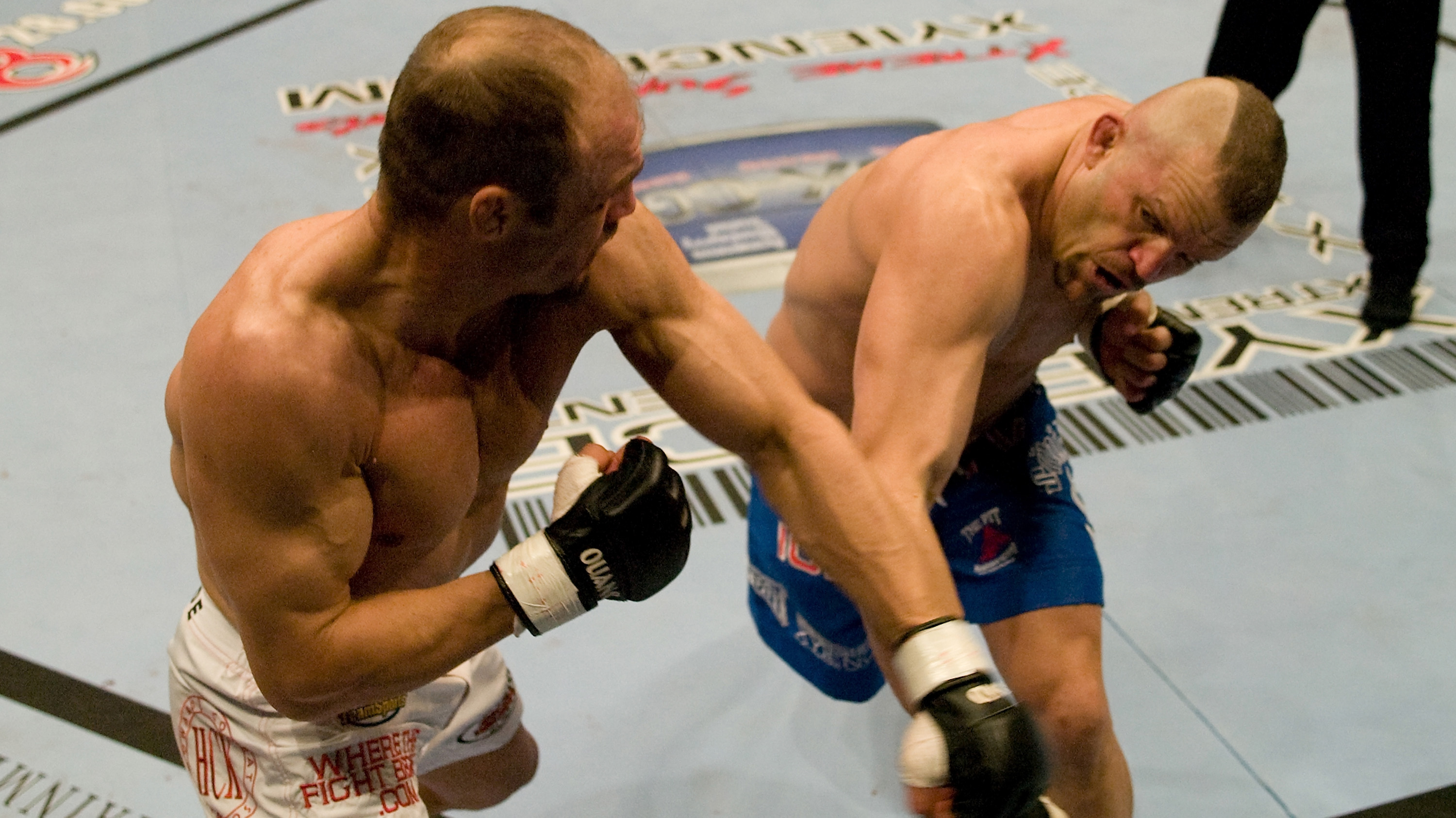 LAS VEGAS, NV - APRIL 16:  (L-R) Randy Couture and Chuck Liddell trade punches at <a href='../event/UFC-52-Couture-vs-Liddell-II'>UFC 52 </a>at the MGM Grand Garden Arena on April 16, 2005 in Las Vegas, Nevada. (Photo by Josh Hedges/Zuffa LLC)