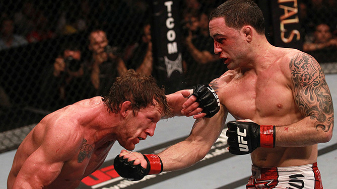 HOUSTON, TX - OCT. 08: (R-L) <a href='../fighter/Frankie-Edgar'>Frankie Edgar</a> punches <a href='../fighter/Gray-Maynard'>Gray Maynard</a> during the UFC 136 event at Toyota Center.  (Photo by Nick Laham/Zuffa LLC)