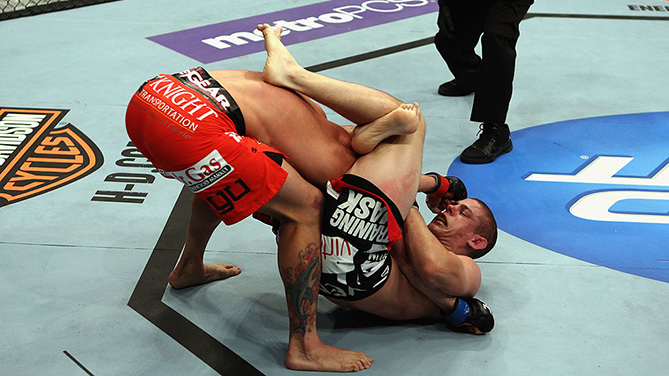 LOS ANGELES, CA - AUG. 04: <a href='../fighter/Joe-Lauzon'>Joe Lauzon</a> secured submission by <a href='../fighter/Jamie-Varner'>Jamie Varner</a>in the triangle choke in the third round during the UFC on FOX at Staples Center. (Photo by Josh Hedges/Zuffa LLC)