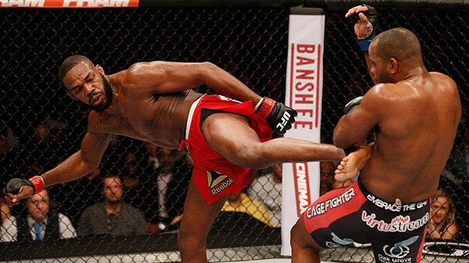 LAS VEGAS, NV - JAN. 03:  Jon Jones (L) kicks Daniel Cormier (R) in their UFC light heavyweight championship bout during the UFC 182 event at the MGM Grand Garden Arena. (Photo by Josh Hedges/Zuffa LLC)