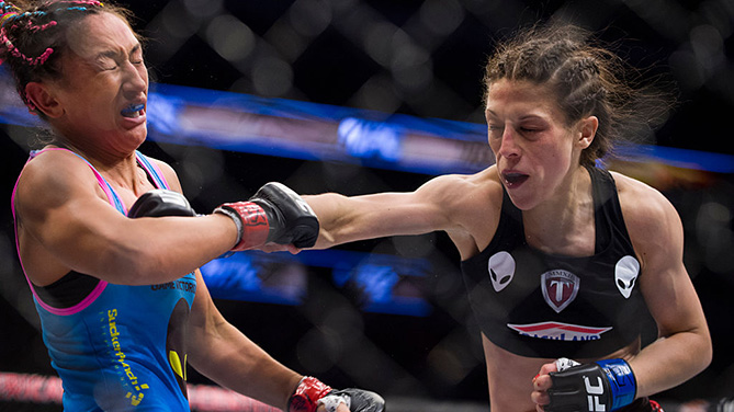 DALLAS, TX - MARCH 14: <a href='../fighter/Joanna-Jedrzejczyk'>Joanna Jedrzejczyk</a> punches <a href='../fighter/Carla-Esparza'>Carla Esparza</a> during UFC 185 at the American Airlines Center. (Photo by Cooper Neill/Zuffa LLC)