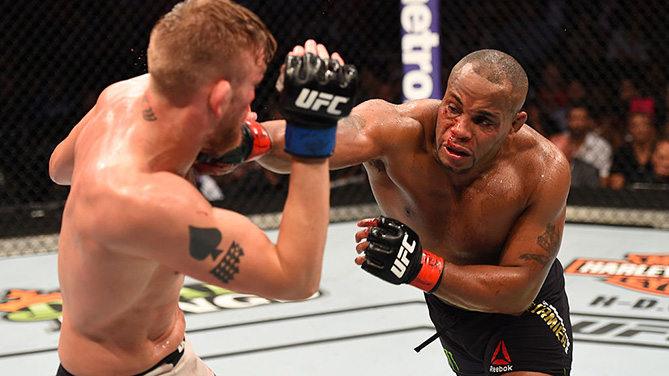 HOUSTON, TX - OCT. 03: (R-L) <a href='../fighter/Daniel-Cormier'>Daniel Cormier</a> punches <a href='../fighter/Alexander-Gustafsson'>Alexander Gustafsson</a> in their UFC light heavyweight championship bout during the UFC 192 event at the Toyota Center. (Photo by Josh Hedges/Zuffa LLC)