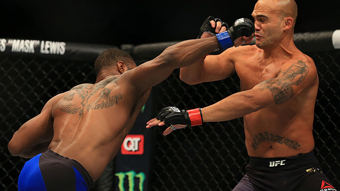 ATLANTA, GA - JULY 30:  (L-R) <a href='../fighter/Tyron-Woodley'>Tyron Woodley</a> delivers a right hand to knock down opponent <a href='../fighter/Robbie-Lawler'>Robbie Lawler</a> in their welterweight championship bout during the UFC 201 event on July 30, 2016. (Photo by Daniel Shirey/Zuffa LLC)