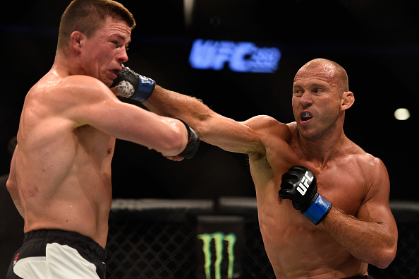 Donald Cerrone punches Rick Story during their welterweight bout at UFC 202