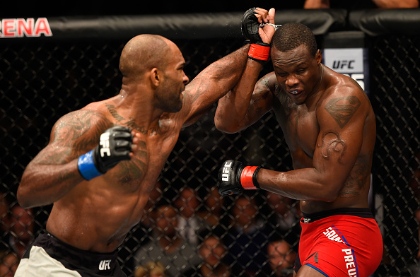 Jimi Manuwa punches <a href='../fighter/Ovince-St-Preux'>Ovince Saint Preux</a> during their light heavyweight bout at UFC 204