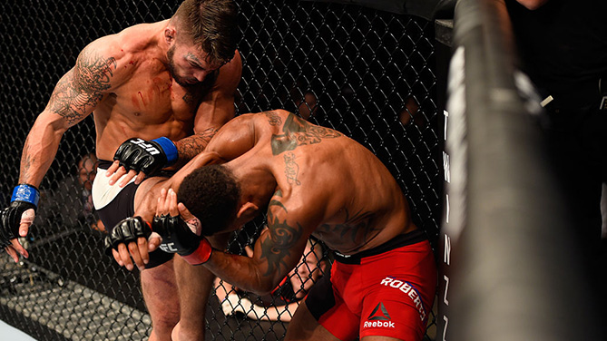 MANCHESTER, ENGLAND - OCT. 08: (L-R) <a href='../fighter/mike-perry'>Mike Perry</a> knees <a href='../fighter/danny-roberts'>Danny Roberts</a> of England in their welterweight bout during the UFC 204 Fight Night at the Manchester Evening News Arena. (Photo by Josh Hedges/Zuffa LLC)