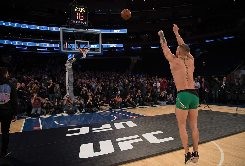 NEW YORK, NY - NOVEMBER 09:  UFC featherweight champion Conor McGrregor of Ireland shoots from the free throw line during an open training session for the media and fans inside Madison Square Garden. (Photo by Brandon Magnus/Zuffa LLC)