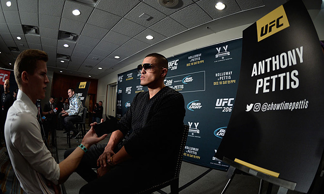 TORONTO, CANADA - DECEMBER 08:  (R-L) Anthony Pettis and Max Holloway speak to the media during the UFC 206 Ultimate Media Day event inside the Westin Harbour Castle Hotel. (Photo by Brandon Magnus/Zuffa LLC)