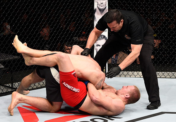 TORONTO, CANADA - DECEMBER 10: (R-L) Misha Cirkunov of Latvia secures a guillotine choke submission against Nikita Krylov of Ukraine in their light heavyweight bout during the UFC 206 event inside the Air Canada Centre on December 10, 2016 in Toronto, Ontario, Canada. (Photo by Jeff Bottari/Zuffa LLC)