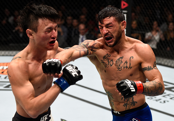 <a href='../fighter/Cub-Swanson'>Cub Swanson</a> punches <a href='../fighter/Dooho-Choi'>Dooho Choi</a> during their UFC 206 bout, which has earned reviews as potentially the Fight of the Year for 2016