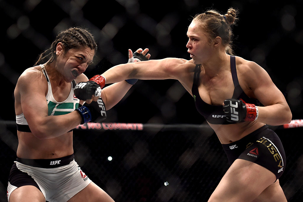 RIO DE JANEIRO, BRAZIL - AUG. 01:  Ronda Rousey of the United States punches Bethe Correia of Brazil in their bantamweight title fight during the UFC 190 Rousey v Correia at HSBC Arena.  (Photo by Buda Mendes/Zuffa LLC)
