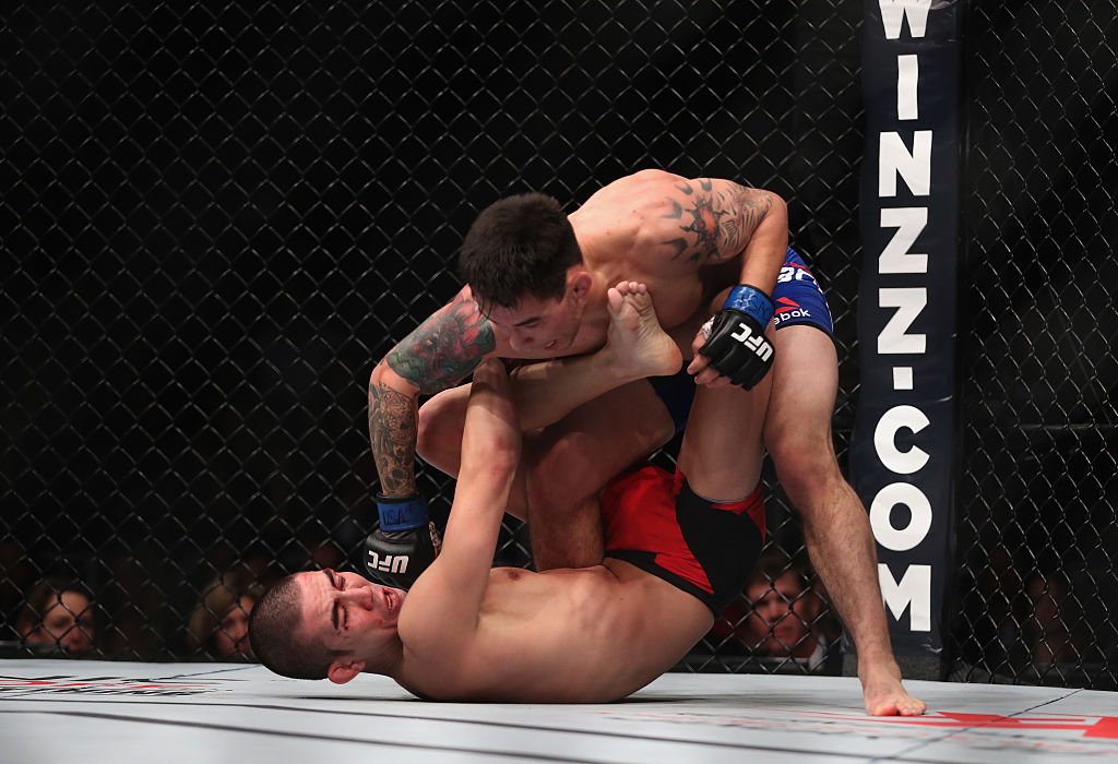 Ray Borg (top) punches Louis Smolka in their flyweight bout. (Photo by Christian Petersen/Getty Images)