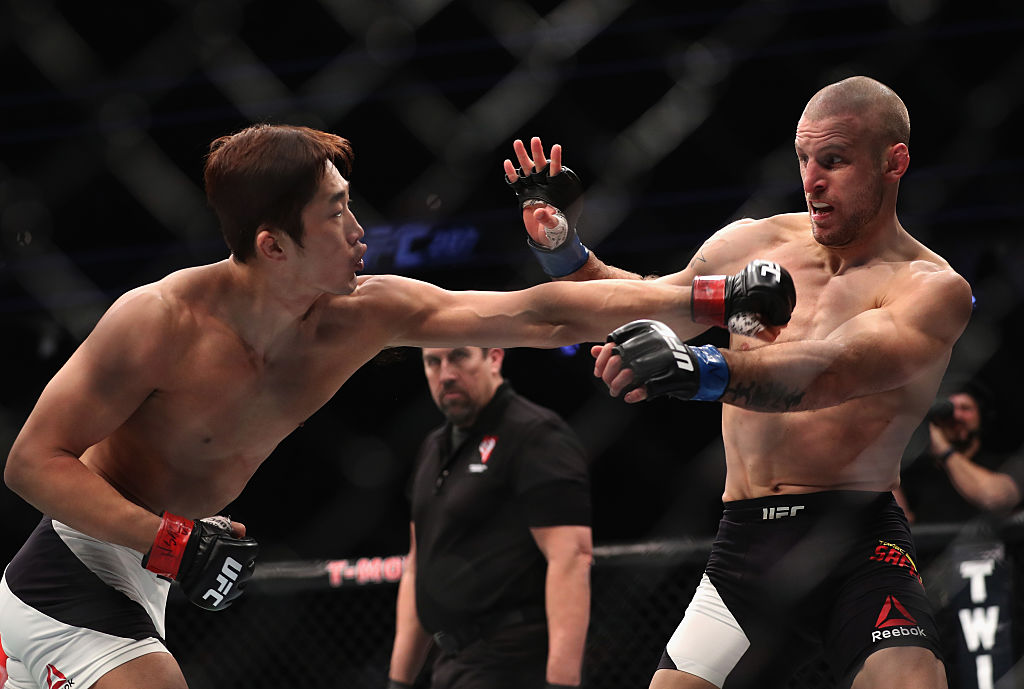 Dong Hyun Kim of South Korea punches Tarec Saffiedine of Belgium in their welterweight bout. (Photo by Christian Petersen/Getty Images)