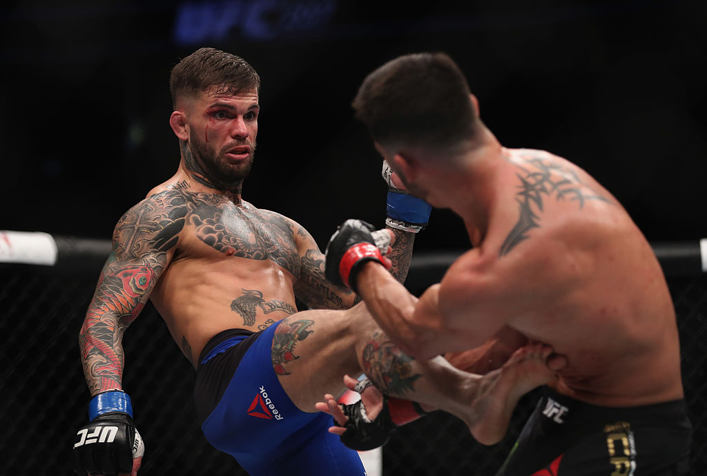 Cody Garbrandt kicks Dominick Cruz in their UFC bantamweight championship bout during UFC 207 (Photo by Christian Petersen/Getty Images)