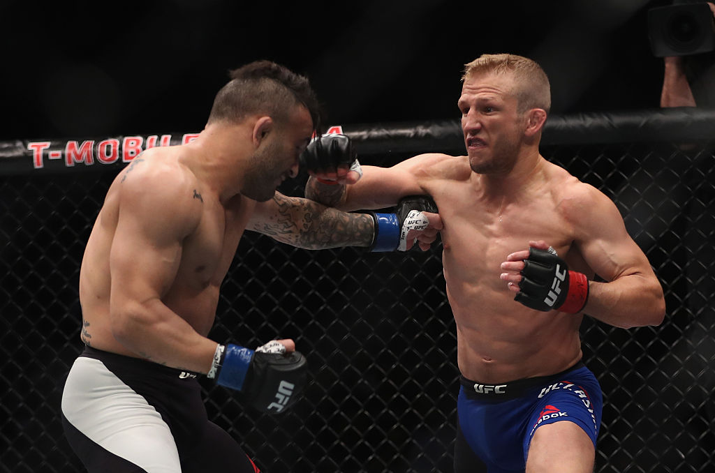 TJ Dillashaw punches John Lineker of Brazil in their bantamweight bout. (Photo by Christian Petersen/Getty Images)