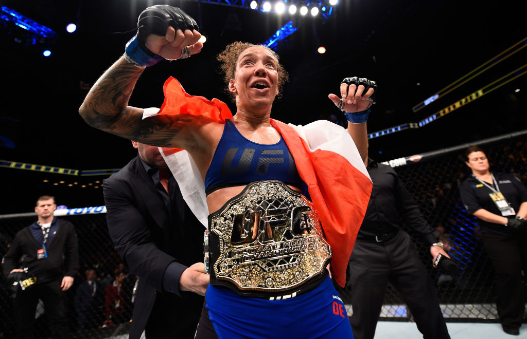 BROOKLYN, NEW YORK - FEBRUARY 11:  Germaine de Randamie of The Netherlands celebrates her victory over Holly Holm in their women's featherweight championship bout during the UFC 208 event inside Barclays Center on February 11, 2017 in Brooklyn, New York. (Photo by Jeff Bottari/Zuffa LLC)