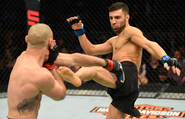 David Teymur kicks Lando Vannata during their lightweight scrap at UFC 209