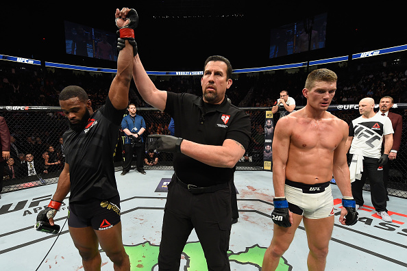 LAS VEGAS, NV - MARCH 04: Tyron Woodley (left) reacts to his victory over Stephen Thompson (right) in their UFC welterweight championship bout during the UFC 209 event at T-Mobile Arena on March 4, 2017 in Las Vegas, Nevada. (Photo by Josh Hedges/Zuffa LLC)