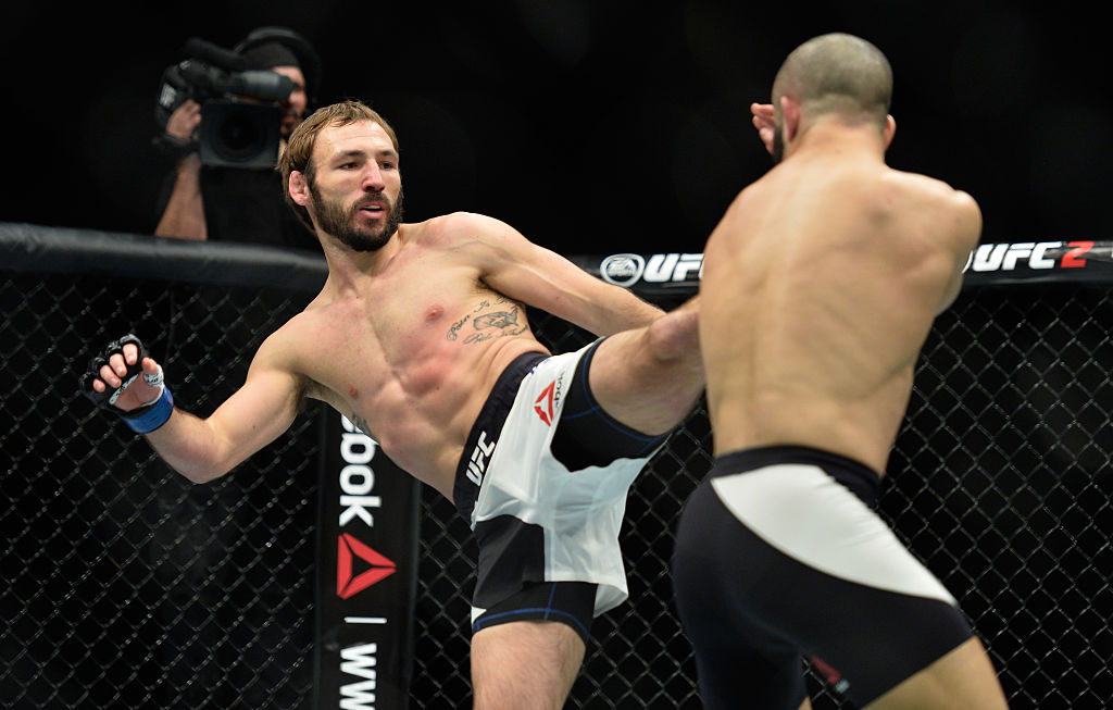 Lando Vannata kicks John Makdessi during their lightweight bout at UFC 206