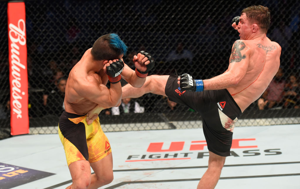 LAS VEGAS, NV - MARCH 04: (R-L) Darren Elkins kicks Mirsad Bektic of Bosnia in their featherweight bout during the UFC 209 event at T-Mobile Arena on March 4, 2017 in Las Vegas, Nevada.  (Photo by Josh Hedges/Zuffa LLC)