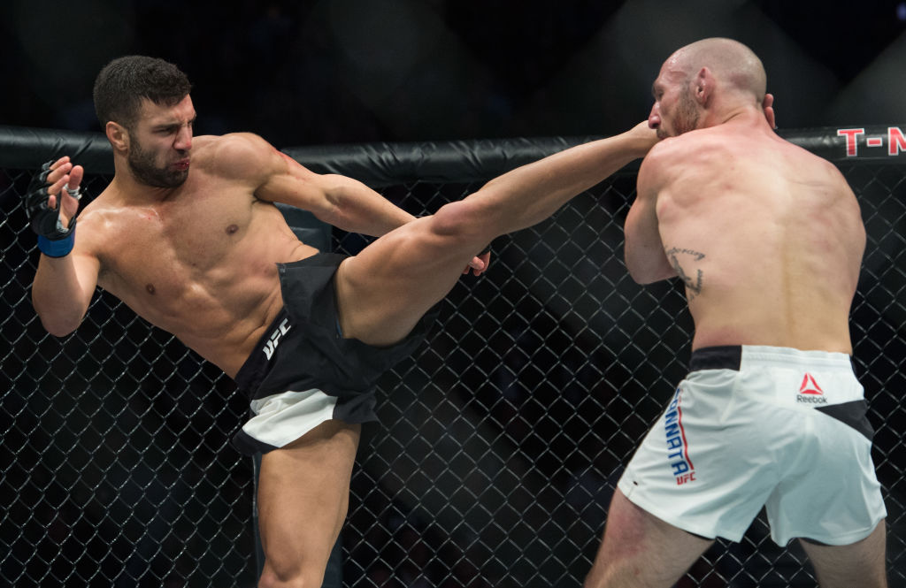 LAS VEGAS, NV - MARCH 04:   (L-R) David Teymur of Sweden kicks Lando Vannata in their lightweight bout during the UFC 209 event at T-Mobile arena on March 4, 2017 in Las Vegas, Nevada. (Photo by Brandon Magnus/Zuffa LLC)