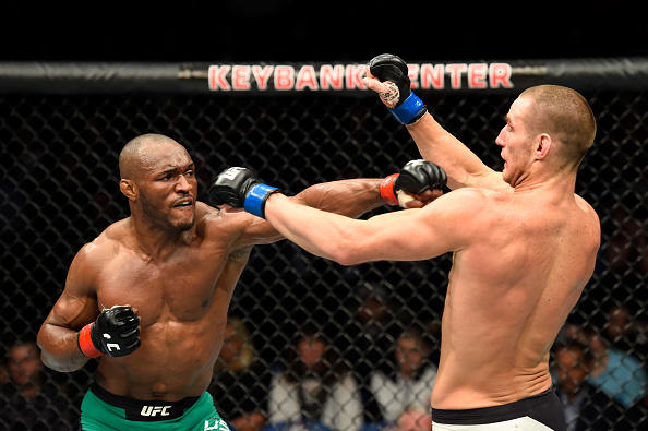 Kamaru Usman punches Sean Strickcland during their welterweight match at UFC 210
