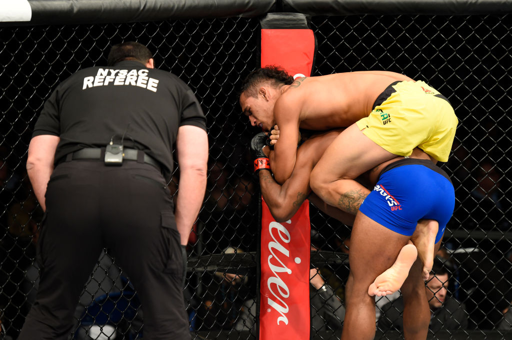 BUFFALO, NY - APRIL 08:  Charles Oliveira secures a rear choke submission victory against Will Brooks in their lightweight bout during the UFC 210 event at KeyBank Center on April 8, 2017 in Buffalo, New York.  (Photo by Josh Hedges/Zuffa LLC)