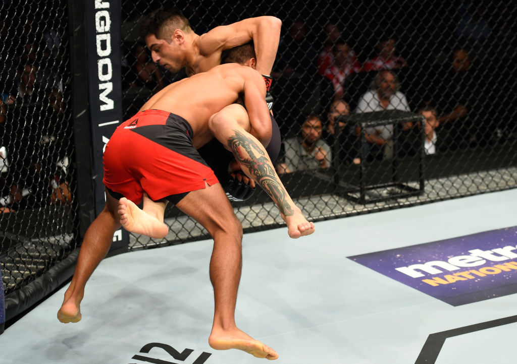 DALLAS, TX - MAY 13:  (L-R) Enrique Barzola takes down Gabriel Benitez in their featherweight fight during the UFC 211 event at the American Airlines Center on May 13, 2017 in Dallas, Texas. (Photo by Josh Hedges/Zuffa LLC)