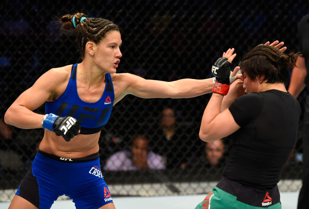DALLAS, TX - MAY 13:  (L-R) Cortney Casey punches Jessica Aguilar in their women's strawweight fight during the UFC 211 event at the American Airlines Center on May 13, 2017 in Dallas, Texas. (Photo by Josh Hedges/Zuffa LLC)
