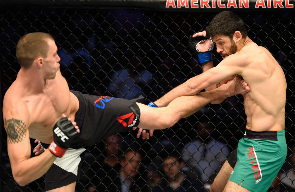 DALLAS, TX - MAY 13:  (L-R) James Vick kicks Marco Polo Reyes in their lightweight fight during the UFC 211 event at the American Airlines Center on May 13, 2017 in Dallas, Texas. (Photo by Josh Hedges/Zuffa LLC)