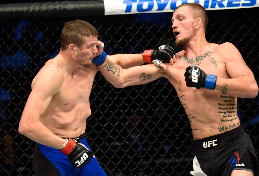 DALLAS, TX - MAY 13:  (R-L) Jason Knight punches Chas Skelly in their featherweight fight during the UFC 211 event at the American Airlines Center on May 13, 2017 in Dallas, Texas. (Photo by Josh Hedges/Zuffa LLC)