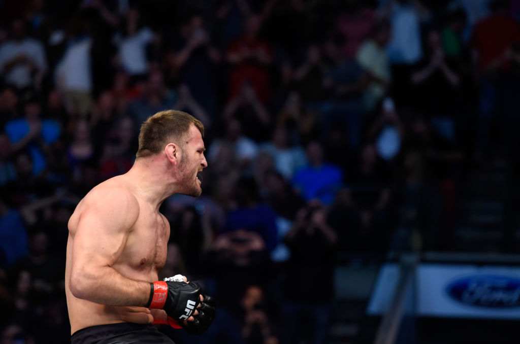 DALLAS, TX - MAY 13:  Stipe Miocic celebrates his TKO victory over Junior Dos Santos in their UFC heavyweight championship fight during the UFC 211 event at the American Airlines Center on May 13, 2017 in Dallas, Texas. (Photo by Josh Hedges/Zuffa LLC)