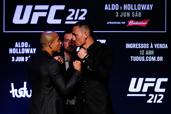 RIO DE JANEIRO, BRAZIL - APRIL 11: UFC Featherweight Champion Jose Aldo of Brazil (L) and challenger Max Holloway of the United States face off during the UFC 212 press conference at Morro da Urca on April 11, 2017 in Rio de Janeiro, Brazil. (Photo by Buda Mendes/Getty Images)