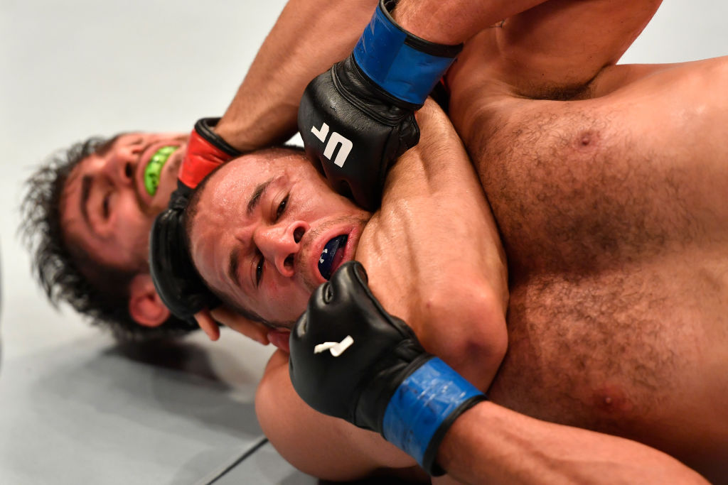 RIO DE JANEIRO, BRAZIL - JUNE 03:  (L-R) Antonio Carlos Junior of Brazil secures a rear choke submission against Eric Spicely in their middleweight bout during the UFC 212 event at Jeunesse Arena on June 3, 2017 in Rio de Janeiro, Brazil. (Photo by Jeff Bottari/Zuffa LLC)