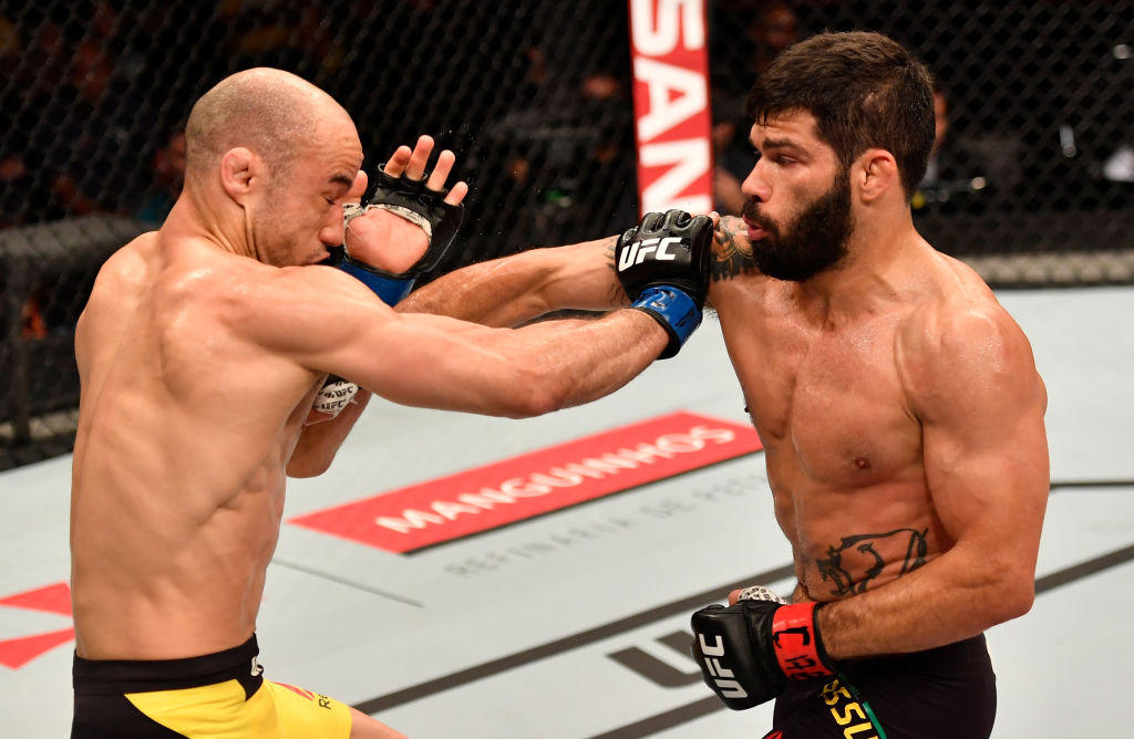 RIO DE JANEIRO, BRAZIL - JUNE 03: (R-L) Raphael Assuncao of Brazil punches Marlon Moraes in their bantamweight bout during the UFC 212 event at Jeunesse Arena on June 3, 2017 in Rio de Janeiro, Brazil. (Photo by Jeff Bottari/Zuffa LLC)