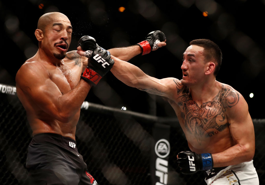 (R-L) Max Holloway punches Jose Aldo of Brazil in their UFC featherweight championship bout during the UFC 212 event at Jeunesse Arena on June 3, 2017 in Rio de Janeiro, Brazil. (Photo by Buda Mendes/Zuffa LLC)