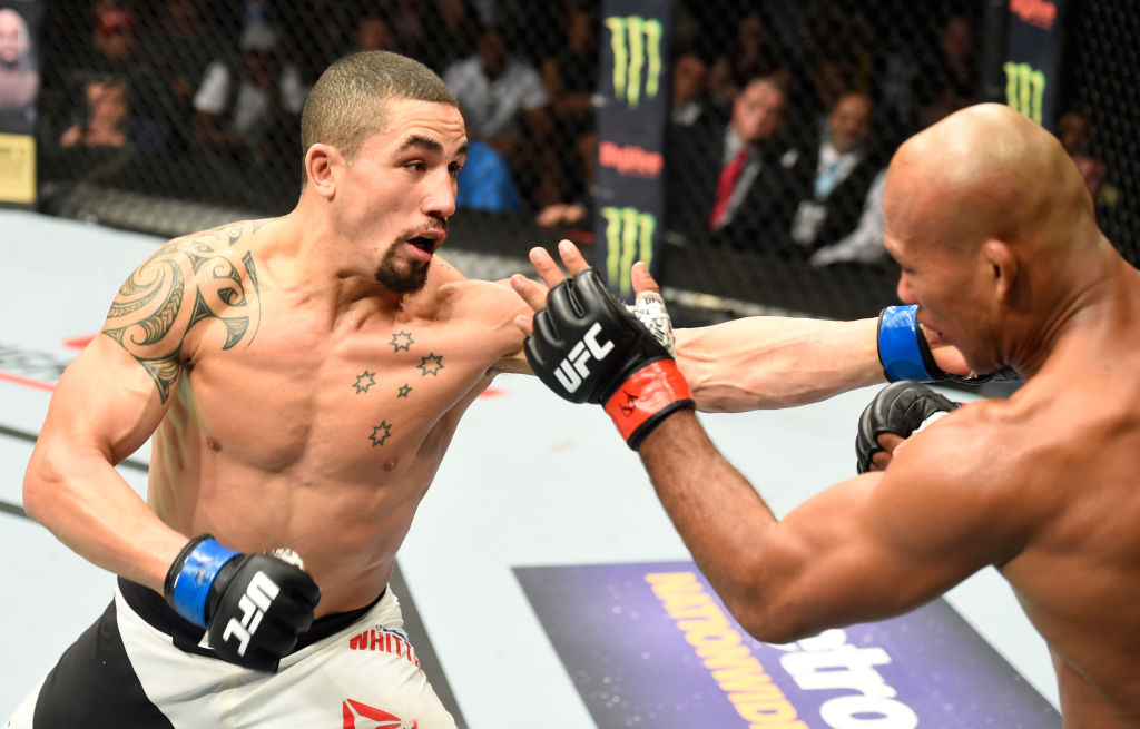 KANSAS CITY, MO - APRIL 15: (L-R) Robert Whittaker of New Zealand punches Jacare Souza of Brazil in their middleweight fight during the UFC Fight Night event at Sprint Center on April 15, 2017 in Kansas City, Missouri. (Photo by Josh Hedges/Zuffa LLC)