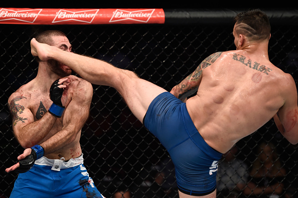 LAS VEGAS, NV - JULY 07: (R-L) James Krause kicks Tom Gallicchio in their welterweight bout during The Ultimate Fighter Finale at T-Mobile Arena on July 7, 2017 in Las Vegas, Nevada. (Photo by Brandon Magnus/Zuffa LLC/Zuffa LLC via Getty Images)