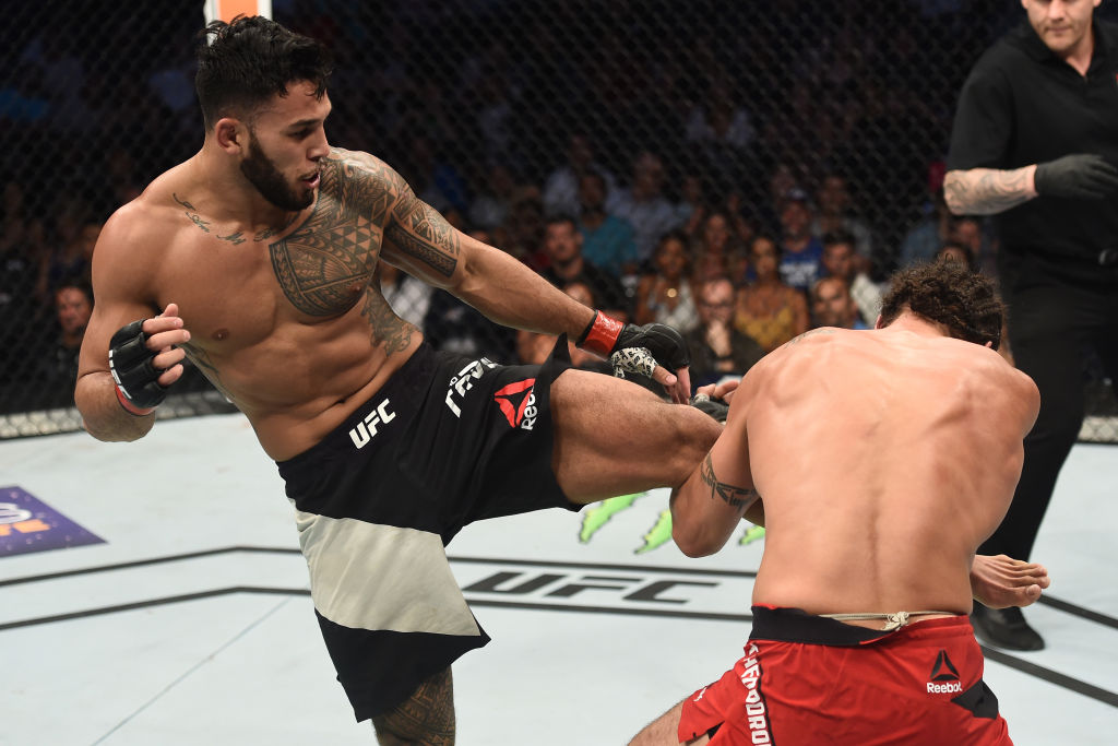 LAS VEGAS, NV - JULY 07: (L-R) <a href='../fighter/Brad-Tavares'><a href='../fighter/Brad-Tavares'>Brad Tavares</a></a> kicks <a href='../fighter/elias-theodorou'><a href='../fighter/elias-theodorou'>Elias Theodorou</a></a> of Canada in their middleweight bout during The Ultimate Fighter Finale at T-Mobile Arena on July 7, 2017 in Las Vegas, Nevada. (Photo by Brandon Magnus/Zuffa LLC)