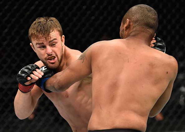 LAS VEGAS, NV - JULY 08:  (R-L) Terrion Ware punches Cody Stamann in their featherweight bout during the UFC 213 event at T-Mobile Arena on July 8, 2017 in Las Vegas, Nevada.  (Photo by Jeff Bottari/Zuffa LLC/Zuffa LLC via Getty Images)