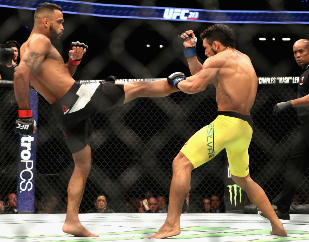 LAS VEGAS, NV - JULY 08:  (L-R) <a href='../fighter/Rob-Font'>Rob Font</a> kicks <a href='../fighter/Douglas-Silva-de-Andrade'>Douglas Silva de Andrade</a> of Brazil in their bantamweight bout during the UFC 213 event at T-Mobile Arena on July 8, 2017 in Las Vegas, Nevada.  (Photo by Christian Petersen/Zuffa LLC)