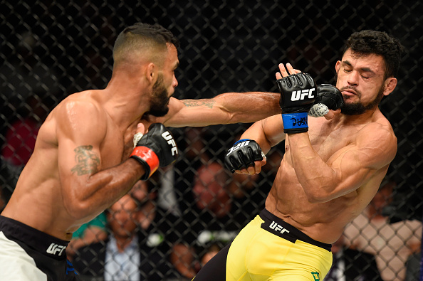 LAS VEGAS, NV - JULY 08:  (L-R) Rob Font punches Douglas Silva de Andrade of Brazil in their bantamweight bout during the UFC 213 event at T-Mobile Arena on July 8, 2017 in Las Vegas, Nevada.  (Photo by Josh Hedges/Zuffa LLC/Zuffa LLC via Getty Images)
