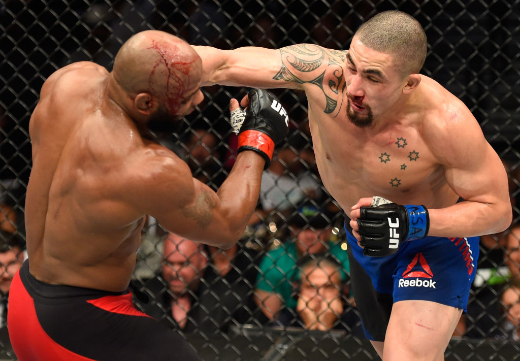 LAS VEGAS, NV - JULY 08:  (R-L) Robert Whittaker of New Zealand punches Yoel Romero of Cuba in their interim UFC middleweight championship bout during the UFC 213 event at T-Mobile Arena on July 8, 2017 in Las Vegas, Nevada.  (Photo by Josh Hedges/Zuffa LLC)