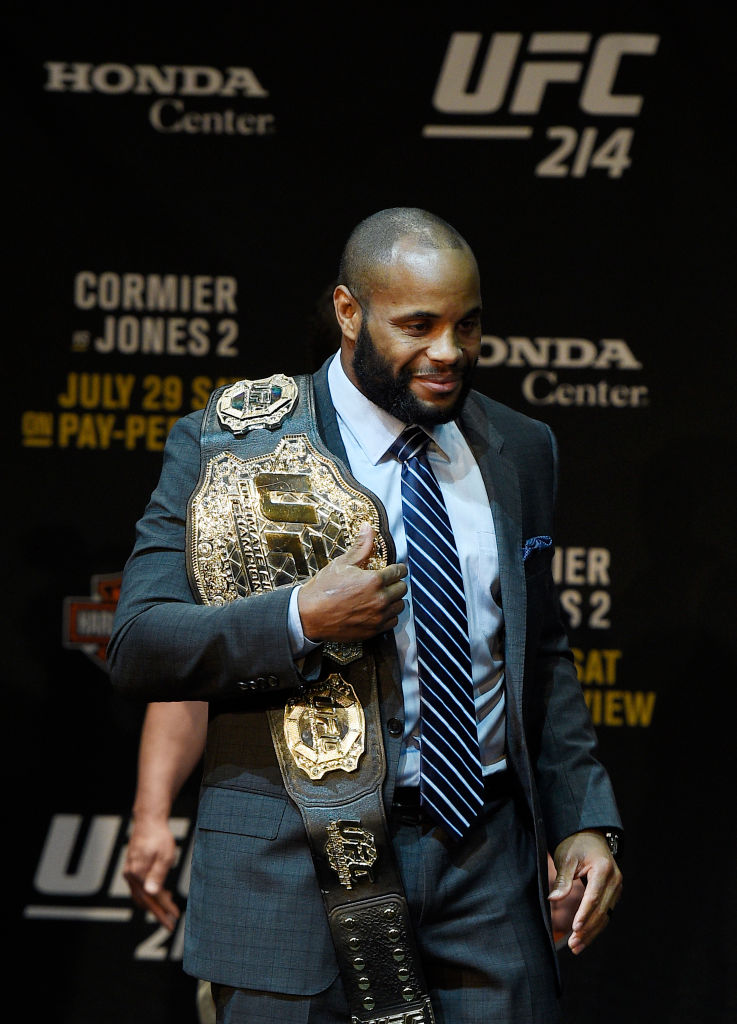 LOS ANGELES, CA - JULY 26: Daniel Cormier poses with the UFC belt after facing off with Jon Jones during the UFC 214 Press Conference at The Novo by Microsoft July 26, 2017 in Los Angeles, California. (Photo by Kevork Djansezian/Zuffa LLC