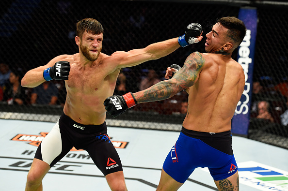 ANAHEIM, CA - JULY 29:  Calvin Kattar punches Andre Fili in their featherweight bout during the UFC 214 event at Honda Center on July 29, 2017 in Anaheim, California.  (Photo by Josh Hedges/Zuffa LLC/Zuffa LLC via Getty Images)