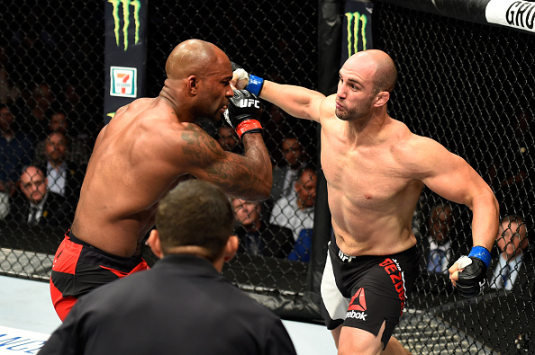 Volan Oezdemir punches Jimi Manuwa during their light heavyweight bout at UFC 214